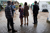 LOUISVILLE, KENTUCKY - MAY 04: Fans stand outside as the rainstorm comes to an end during Thurby at Churchill Downs on May 4, 2017 in Louisville, Kentucky. (Photo by Scott Serio/Eclipse Sportswire/Getty Images)