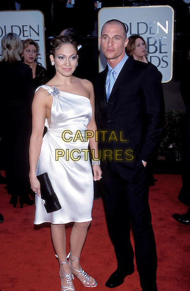JENNIFER LOPEZ & MATTHEW MCCONAUGHEY.Golden Globe Awards.Ref: 10304.one shoulder dress, highlights, smiling, silver dress, brooch, strappy sandals, shoes, red carpet, full length, full-length.www.capitalpictures.com.sales@capitalpictures.com.©Capital Pictures