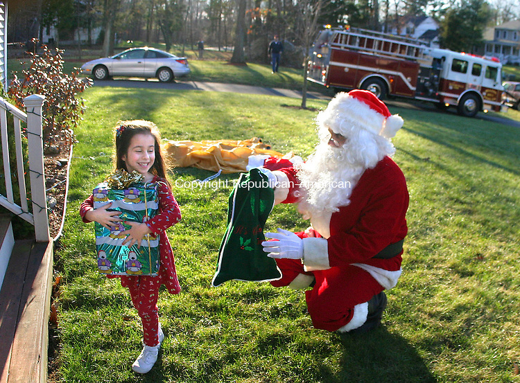 BEACON FALLS, CT- 16 DECEMBER 2006- 121606JW03.jpg  -- Olivia Vitale age 5 of Beacon Falls is all smiles after receiving a gift from Santa Claus Saturday afternoon. Santa rode around town in Beacon Hose Co. #1 Engine 3 Saturday distributing gifts.  Jonathan Wilcox Republican-American