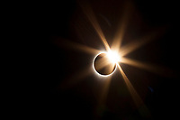 Total Solar Eclipse with diamond ring optical flare and corolla; Ola Idaho Communiy Center