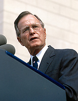 ***FILE PHOTO*** George H.W. Bush Has Passed Away<br /> Washington, DC. 9-29-1990<br /> President George H.W. Bush addresses crowd at the National Catherdal cornerstone ceremony. <br /> <br /> CAP/MPI/MRN<br /> &copy;MRN/MPI/Capital Pictures