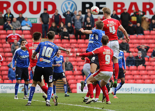 09.04.2016. Oakwell, Barnsley, England. Skybet League One. Barnsley versus Chesterfield. Barnsley's Marc Roberts heads the ball towards goal
