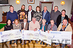 The Treshing for Cancer committee presents three cheques of €9,000 to the Oncology Unit KGH,  Recovery Haven and St Josephs Home Killorglin in Beaufort on Saturday night also Niall O'Leary from Regeneron presented a cheque of €3,000 to the Treshing for Cancer committee front row l-r: Theresa Walsh Oncology Unit KGH, Marian Barnes Recovery Haven, Siobhain McSweeney, Brendan Ferris organisor, Sr Helena, Sr Elizabeth, Niall O'Leary Regeneron. Back row: kuddy Clifford, James king, Randall Joy, Hazel Joy, jim Clifford, Mike O'Shea and Kathleen Breen