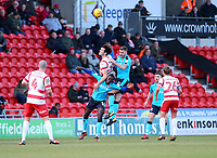 Ashley Eastham of Fleetwood Town and Toumani Diagouraga of Fleetwood Town challenging for the ball during the Sky Bet League 1 match between Doncaster Rovers and Fleetwood Town at the Keepmoat Stadium, Doncaster, England on 17 February 2018. Photo by Leila Coker / PRiME Media Images.