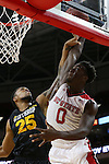 27 November 2015: NC State's Abdul-Malik Abu (0) is fouled by Winthrop's Zach Price (25). The North Carolina State University of North Carolina Wolfpack hosted the Winthrop University Eagles at the PNC Arena in Raleigh, North Carolina in a 2015-16 NCAA Division I Men's Basketball game. NC State won the game 87-79.