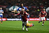 Matty Taylor of Bristol City is challenged by Leandro Bacuna of Reading during the Sky Bet Championship match between Bristol City and Reading at Ashton Gate, Bristol, England on 26 December 2017. Photo by Paul Paxford.