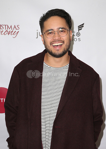 "LOS ANGELES, CA - NOVEMBER 7: Travis-Atreo, at Premiere of Lifetime's ""Christmas Harmony"" at Harmony Gold Theatre in Los Angeles, California on November 7, 2018. Credit: Faye Sadou/MediaPunch"
