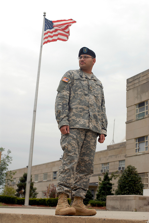 An Army National Guard soldier is photographed in front of the DC Armory.