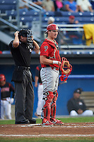 Umpire Brandin Sheeler and Williamsport Crosscutters catcher Austin Bossart (47) during a game against the Batavia Muckdogs on August 29, 2015 at Dwyer Stadium in Batavia, New York.  Williamsport defeated Batavia 7-3.  (Mike Janes/Four Seam Images)