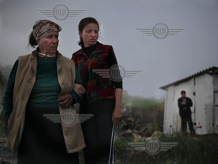 Elvira and Jiliara talk to one another. Jiliara's husband in the background is the only man active in Nikita, an unofficial Tatar community.