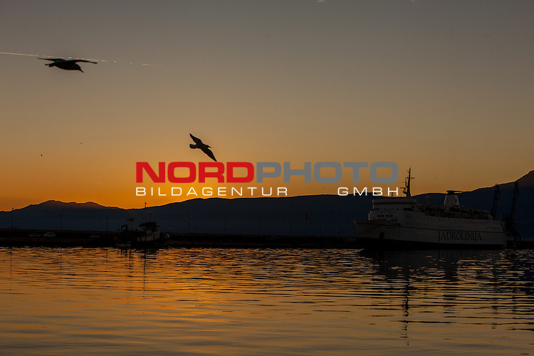 11.12.2013., Rijeka, Croatia - Sunset in port of Rijeka. Photo: Nel Pavletic/PIXSELL <br /> Foto &copy;  nph / Pixsell <br /> ***** Attention only in GER *****