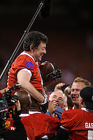 SAN FRANCISCO, CA - JULY 12:  Former San Francisco 49ers owner Eddie DeBartolo, Jr. is carried off the field by his team after scoring the game-winning touchdown at the end of the Legends of Candlestick flag football game at Candlestick Park in San Francisco, California on July 12, 2014. Photo by Brad Mangin