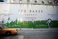 A billboard on a construction shed announced the imminent arrival of a Ted Baker clothing store on Fifth Avenue in New York on Black Friday, the day after Thanksgiving, Friday, November 25, 2011. Ted Baker Plc's  CFO Lindsay Page recently announced that the company expects improved sales during the holiday shopping season. (© Richard B. Levine)