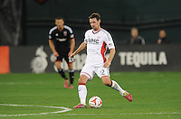 Washington, D.C.- March 29, 2014. Andy Dorman (12) of the New England Revolution.  D.C. United defeated the New England Revolution 2-0 during a Major League Soccer Match for the 2014 season at RFK Stadium.