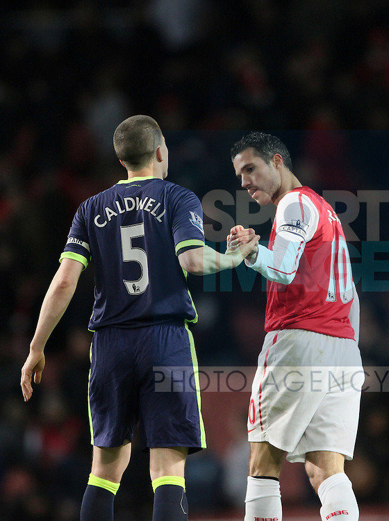 Arsenals Robin Van Persie refuses to shake hands with Wigans Gary Caldwell at the final whistle and bends his fingers..Arsenal v Wigan, Barclays Premier League, the Emirates, London. 16th April 2012.--------------------.Sportimage +44 7980659747.picturedesk@sportimage.co.uk.http://www.sportimage.co.uk/.Editorial use only. Maximum 45 images during a match. No video emulation or promotion as 'live'. No use in games, competitions, merchandise, betting or single club/player services. No use with unofficial audio, video, data, fixtures or club/league logos.