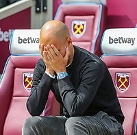 Pep Guardiola (Manager) of Manchester City holds his head in his hands ahead of the Premier League match between West Ham United and Manchester City at the London Stadium, London, England on 10 August 2019. Photo by David Horn.