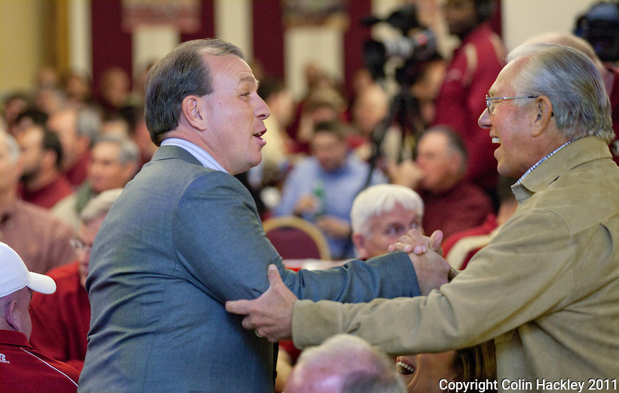 TALLAHASSEE, FLA. 2/2/11-FSUSIGN020211CH-Head Coach Jimbo Fisher, left, is congratulated on landing another top recruiting class during the 2011 national signing day war party in Tallahassee...COLIN HACKLEY PHOTO
