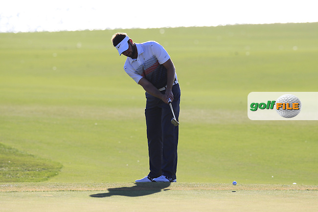 Scott Jamieson (SCO) putts on the 14th green during Sunday's Final Round of the 2013 Portugal Masters held at the Oceanico Victoria Golf Club. 13th October 2013.<br /> Picture: Eoin Clarke/www.golffile.ie