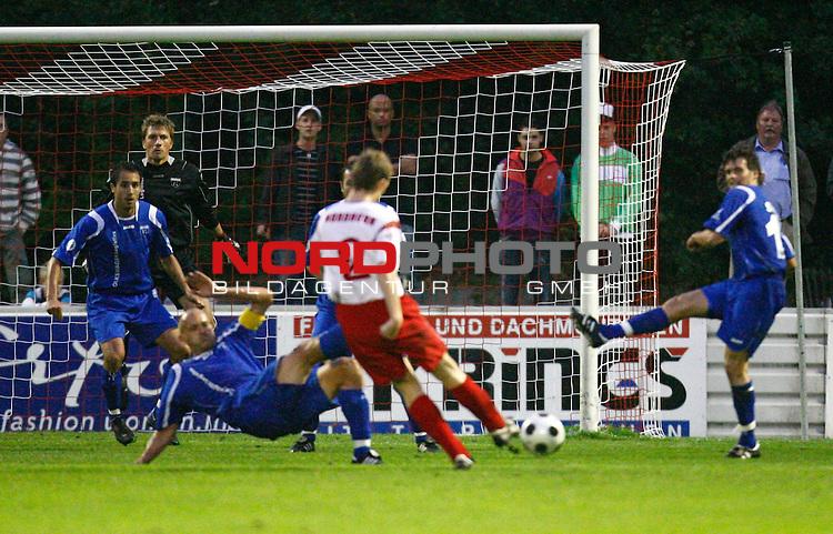 NFV-Pokal Achtelfinale<br /> Torschss von Hartmut Vrielmann (Eintracht Nordhorn #2), am Boden: Rudolf Zedi (Kickers Emden GER #25)<br /> Foto &copy; nph (  nordphoto  )<br /> <br /> <br /> <br />  *** Local Caption ***