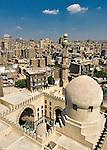 Cairo, Egypt -- A working mosque (close foreground) stands directly adjoining and dominates the view of Cairo when viewed from this side of the minaret of the historic ibn Tulun mosque. © Rick Collier / RickCollier.com