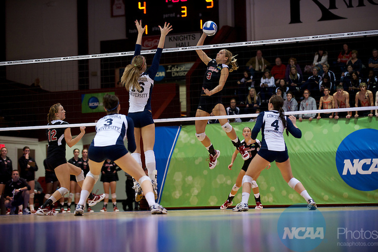 04 DEC 2010:  Sam Macks (3) of Tampa spikes the ball past Emily Palkert (16) of Concordia St. Paul during the Division II Women's Volleyball Championship held at Knights Hall on the Bellarmine campus in Louisville, KY.  Concordia St. Paul won over Tampa 3-1. Josh Duplechian/NCAA Photos