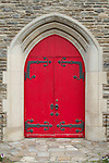 Antique red entry door to a small baptist church in Gatlinburg, Tennessee
