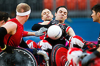 18 APR 2012 - LONDON, GBR - Canadian Patrice Dagenais (CAN) (Class 1.0) (right) fumbles the ball as he attempts to avoid challenges during the London International Invitational Wheelchair Rugby Tournament match against Great Britain at the Olympic Park Basketball Arena in Stratford, London, Great Britain .(PHOTO (C) 2012 NIGEL FARROW)