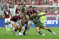 27th October 2019; Olympic Grande Torino Stadium, Turin, Piedmont, Italy; Serie A Football, Torino versus Cagliari; Luca Cigarini of Cagliari shields the ball from Cristian Ansaldi and Lorenzo De Silvestri of Torino FC - Editorial Use