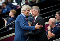 West Ham Utd Manager Manuel Pellegrini welcomes Man Utd manager Ole Gunnar Solskjaer during the Premier League match between West Ham United and Manchester United at the Olympic Park, London, England on 22 September 2019. Photo by Andy Rowland / PRiME Media Images.