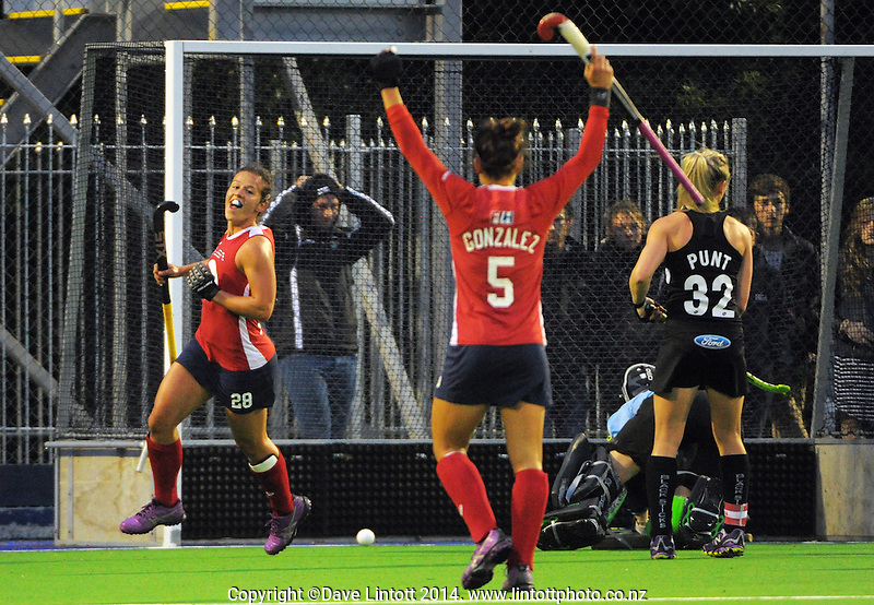 USA's Caitlin Van Sickle (left) celebrates scoring the second goal in her team's 2-0 victory during the international women's hockey match between the NZ Black Sticks and USA at Endeavour Twin Turfs, Palmerston North, New Zealand on Thursday, 23 October 2014. Photo: Dave Lintott / lintottphoto.co.nz