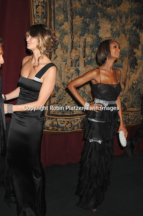 Elle MacPherson and Iman in Valentino..arriving at The 7th on Sale Black Tie Gala Dinner on ..November 15, 2007 at The 69th Regiment Armory in New York. The Fashion Industry's Battle Against HIV and AIDS..will benefit...Robin Platzer, Twin Images