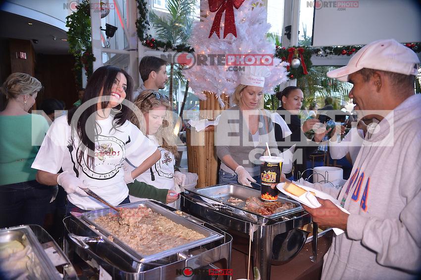 MIAMI, FL - NOVEMBER 22: Adriana De Maura and Lea Black participate in 5th Annual Thanksgiving Feed A Friend at Bongos Cuban Cafe on November 22, 2012 in Miami, Florida. © MPI10/MediaPunch Inc /NortePhoto