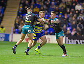 2nd February 2019, Halliwell Jones Stadium, Warrington, England; Betfred Super League rugby, Warrington Wolves versus Leeds Rhinos; Josh Charnley is tackled by Ash Handley and Konrad Hurrell