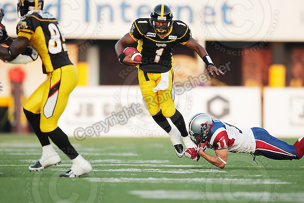 June 26, 2008; Hamilton, ON, CAN; Hamilton Tiger-Cats quarterback Casey Printers (1) tackled by Montreal Alouettes defensive back Chip Cox (11). CFL football - Montreal Alouettes defeated the Hamilton Tiger-Cats 33-10 at Ivor Wynne Stadium. Mandatory Credit: Ron Scheffler-www.ronscheffler.com. Copyright (c) Ron Scheffler