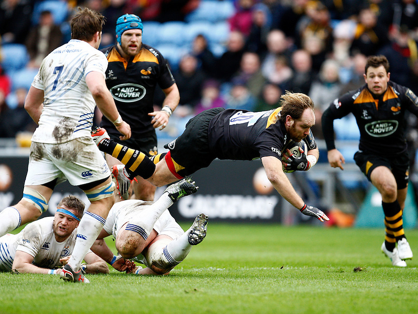 Photo: Richard Lane/Richard Lane Photography. Wasps v Leinster Rugby.  European Rugby Champions Cup. 24/01/2015. Wasps' Andy Goode flies in attacks.