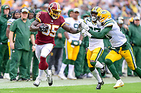 Landover, MD - September 23, 2018: Washington Redskins tight end Vernon Davis (85) breaks free for a big gain to set up a touchdown right before halftime during game between the Green Bay Packers and the Washington Redskins at FedEx Field in Landover, MD. The Redskins get the win 31-17 over the visiting Packers. (Photo by Phillip Peters/Media Images International)