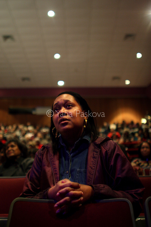 "Monette McLin, 39, actress from Chicago, cries while watching the inauguration of Barack Obama as President of the United States in the theater of the DuSable Museum of African-American History in Chicago, Illinois, on the Presidential Inauguration Day, Tuesday, January 20, 2009.  McLin said of Obama, ""That is a very inspirational man. I need that,"" as a self-described ""struggling"" actress. McLin's phone number is: 901.412.6568 (Photo by Yana Paskova for The New York Times)..Assignment ID: 30075164A"