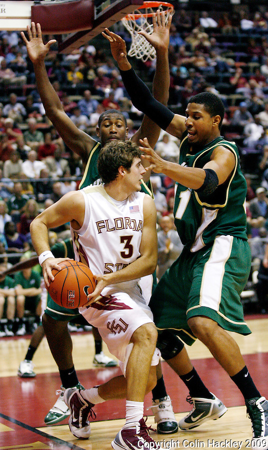 TALLAHASSEE, FL 11/16/09-FSU-JU BB09 CH11-Florida State's Luke Loucks is trapped by Jacksonville's Glenn Powell, left, and Lehmon Colbert during first half action Monday at the Donald L. Tucker Center in Tallahassee...COLIN HACKLEY PHOTO