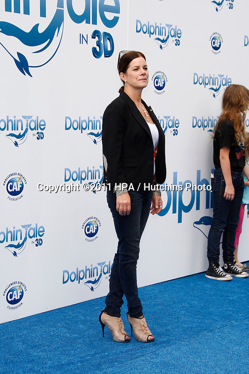 LOS ANGELES - SEP 17:  Marcia Gay Harden arrives at the Warner Bros.' World Premiere of 'Dolphin Tale'  at The Regency Village Theater on September 17, 2011 in Westwood, CA