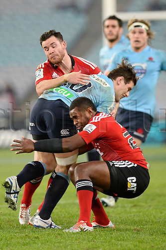 23.05.2015.  Sydney, Australia. Super Rugby. NSW Waratahs versus the Crusaders. Waratahs fly half Bernard Foley is tackled by the Crusaders. The Waratahs won 32-22.