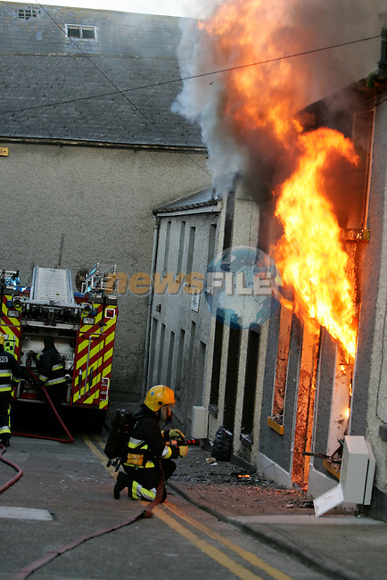 Drogheda Fire service received a call to a house fore in the Trinity Street area of Drogheda around 5.20 am on Thursday Morning with the report of people inside. Two units tackled the blaze which engulfed the house and smoke damaged the adjoining homes..Photo: Newsfile/Fran Caffrey....