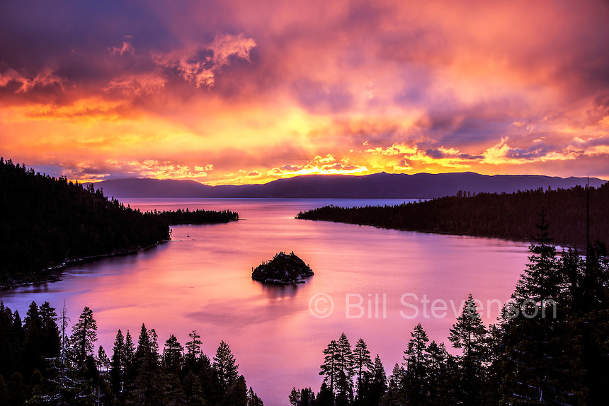 Emerald Bay at Lake Tahoe at sunrise. A rare summer Pacific storm rolled through during late June, 2013. There was a narrow cloudless slit on the eastern horizon that allowed the sun to peek through. For a few brief minutes a spectacular light show lit up  the morning.Then the rain began.