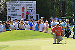 Padraig Harrington eyeing up his putt in the 5th.during round three of the BMW PGA championship 2010 at Wentworth golf club, Surrey England..Picture Fran Caffrey/Newsfile.ie