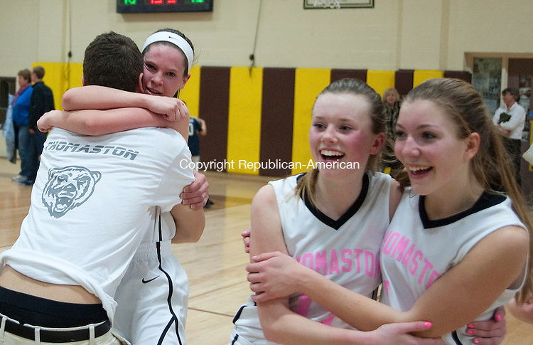 THOMASTON, CT 15 FEBRUARY 2013-021513JS08--Senior Maggie Eberhardt (22), left, gets a hug from a friends while she and her teammates celebrate their 55-48 win over Nonnewaug to capture the Berkshire League title Friday at Thomaston High School..Jim Shannon Republican-American
