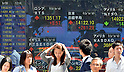 September 9, 2013, Tokyo, Japan - Japanese stocks jump higher on the Tokyo Stock Exchange market on Monday, September 9, 2013, boosted by Tokyo winning its bid to host the 2020 Olympics, bright news for construction and real estate communities. The benchmark Nikkei 225 index, which fell 1.45 per cent on Friday, opened up 2.03 per cent and expanded its gain 390.21 points to 14,251.02 in the first few minutes of trade before coming down to 14,122.10 in the morning trading. (Photo by Natsuki Sakai/AFLO)