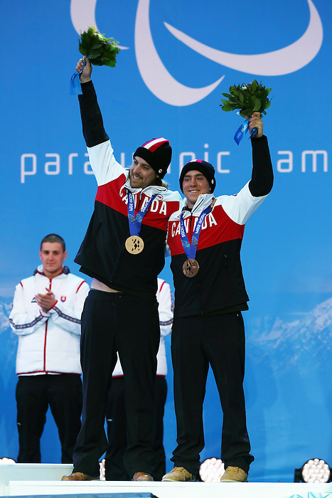 Sochi, Russia, 09/03/2014. Canadian skier Mac Marcoux and guide Robin Femy celebrate their Bronze medal win in the mens's Super G visually impared at the Sochi 2014 Paralympic Winter Games in Sochi Russia. Photo(Scott Grant/Canadian Paralympic Committee)
