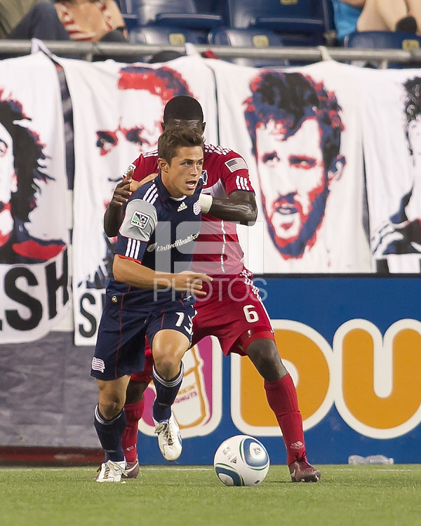 New England Revolution midfielder Ryan Guy (13) comes out of the corner with the ball as Chicago Fire defender Jalil Anibaba (6) defends. In a Major League Soccer (MLS) match, the New England Revolution tied the Chicago Fire, 1-1, at Gillette Stadium on June 18, 2011.