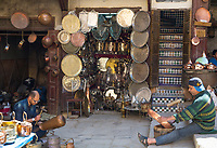Fes, Morocco.  Place Seffarine.  Metalworkers Shaping a Copper Bowl and a Metal Vase.