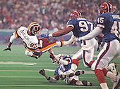 Washington Redskins wide receiver Ricky Sanders (83) is tackled after gaining one yard on an end-around play against the Buffalo Bills during Super Bowl XXVI in Minneapolis, Minnesota on January 26, 1992.  The Redskins won the game and the World Championship 37 - 24.<br /> Credit: Howard L. Sachs / CNP