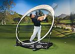 Golf swing instructor at Sports Club LA golf annex.